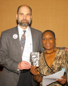 "SDUSA Chair Rick D'Loss and ""It Takes a Village"" Chair Beverly Newkirk hold a picture of Bayard Rustin"